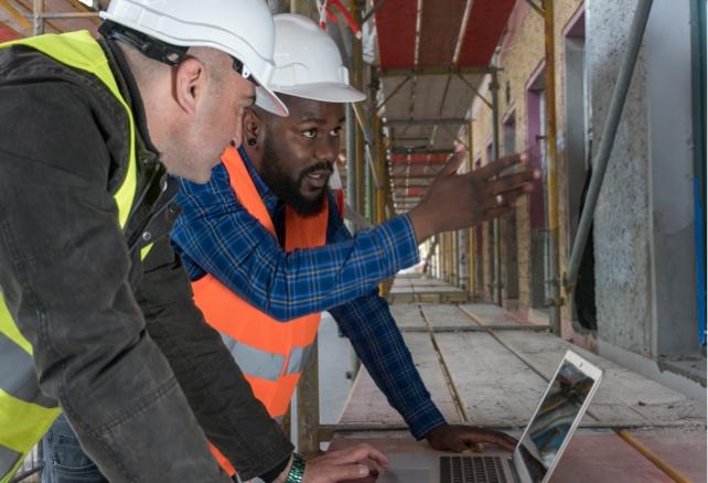two men discussing construction plans